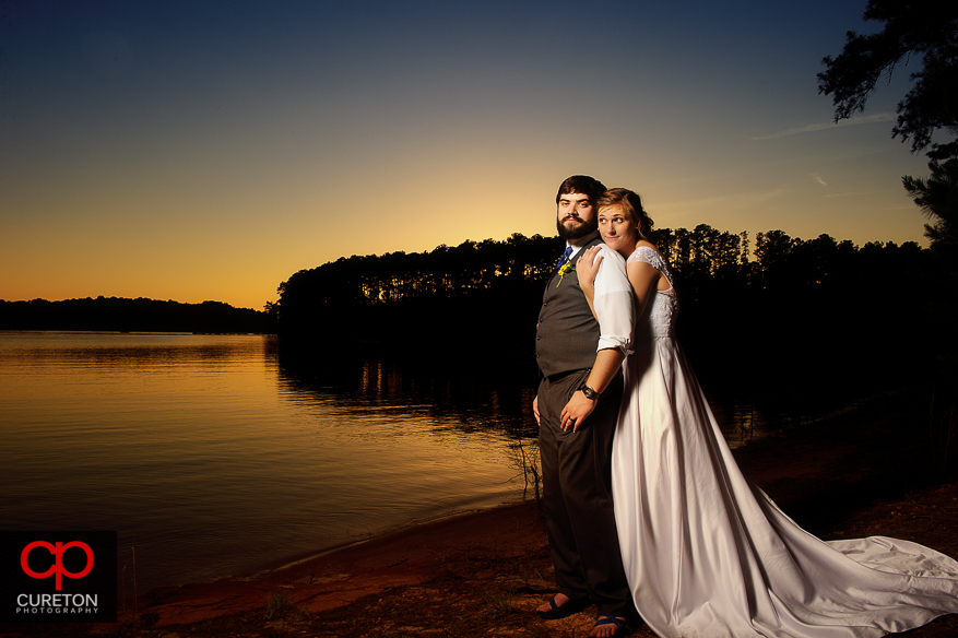 Bride and groom at sunset on the Clemson outdoor lab beach.
