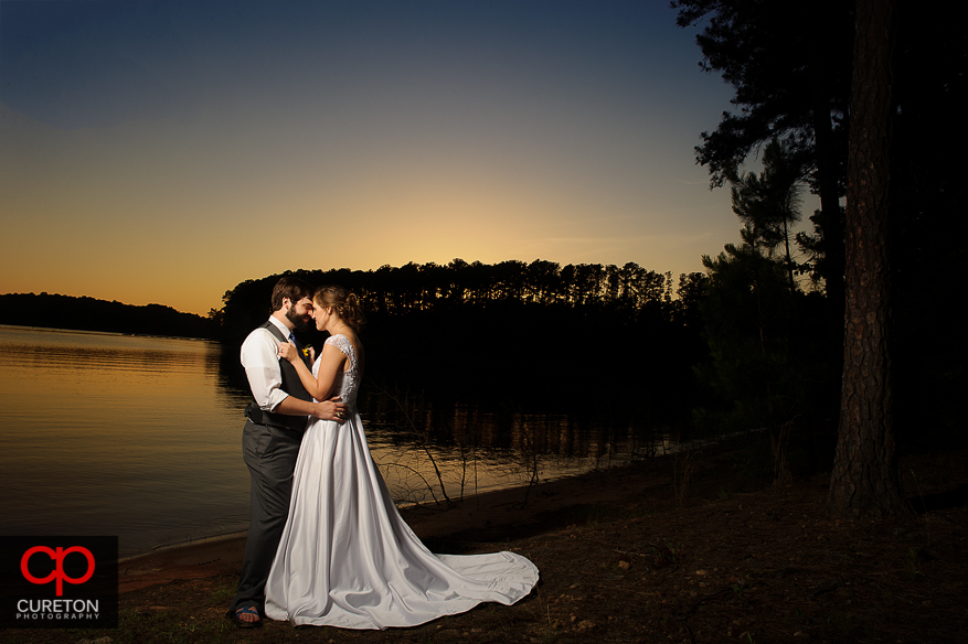 Married couple after their wedding at the Clemson outdoor lab at sunset.
