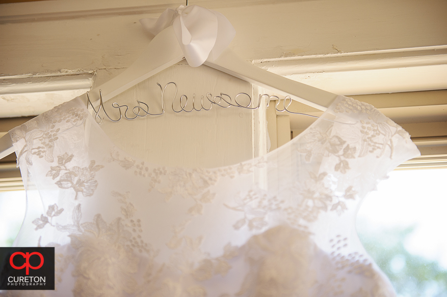 Close-up of the customized hanger for the bridal gown.