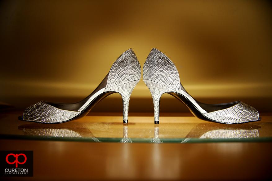 Sideways shot of the bride shoes.