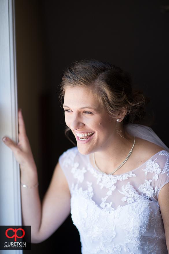 Bride laughing in beautiful window light.