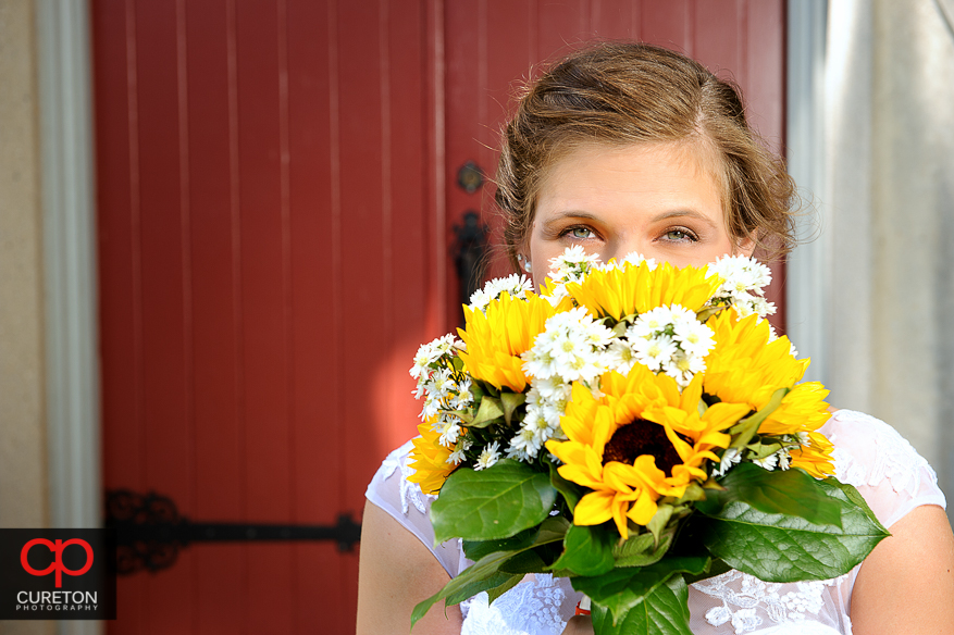 The bride and her bouquet before her Clemson wedding.