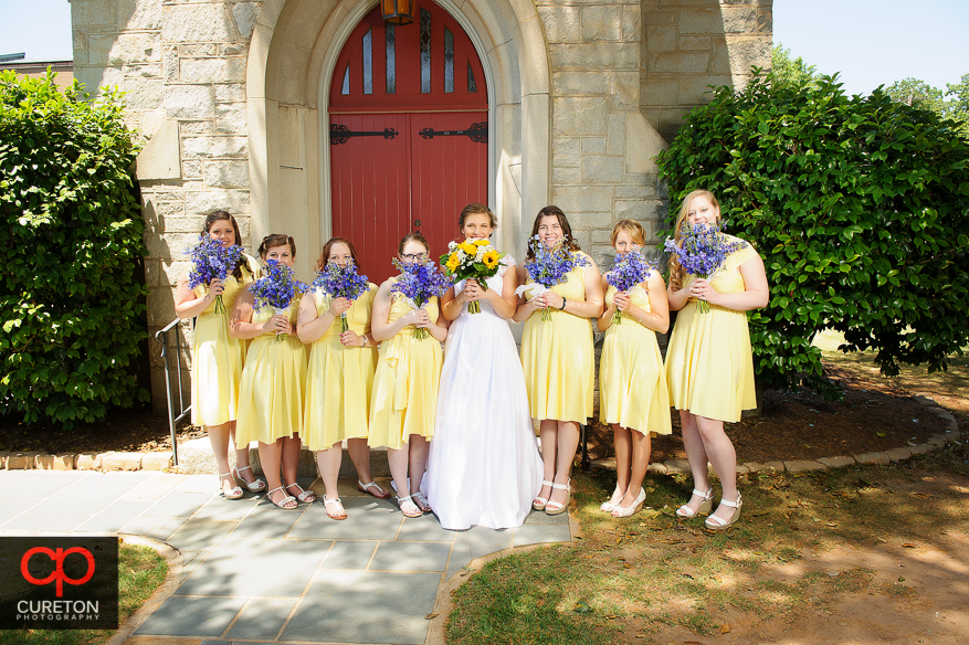 The bride and her bridesmaids standing in front of the church before her wedding in Clemson.