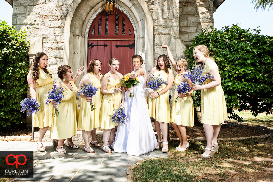 Creative shot of the bride and the bridesmaids looking at her wedding ring.