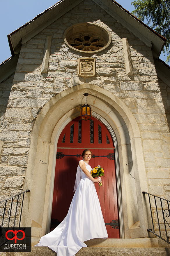 The bride posing in front of the church.