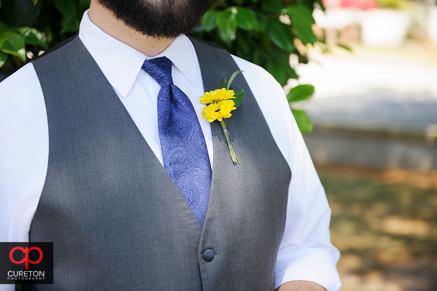 Close up of a sunflower boutonniere.