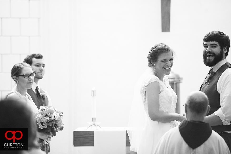 The bride laughing during her ceremony.