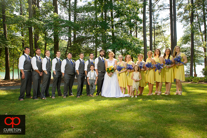 The bridal party standing outside the Clemson outdoor lab after the wedding.