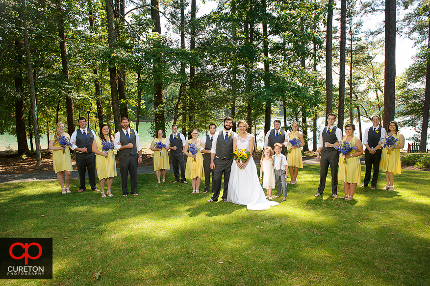 Creative and elegant photo of the bridal party on the lake.