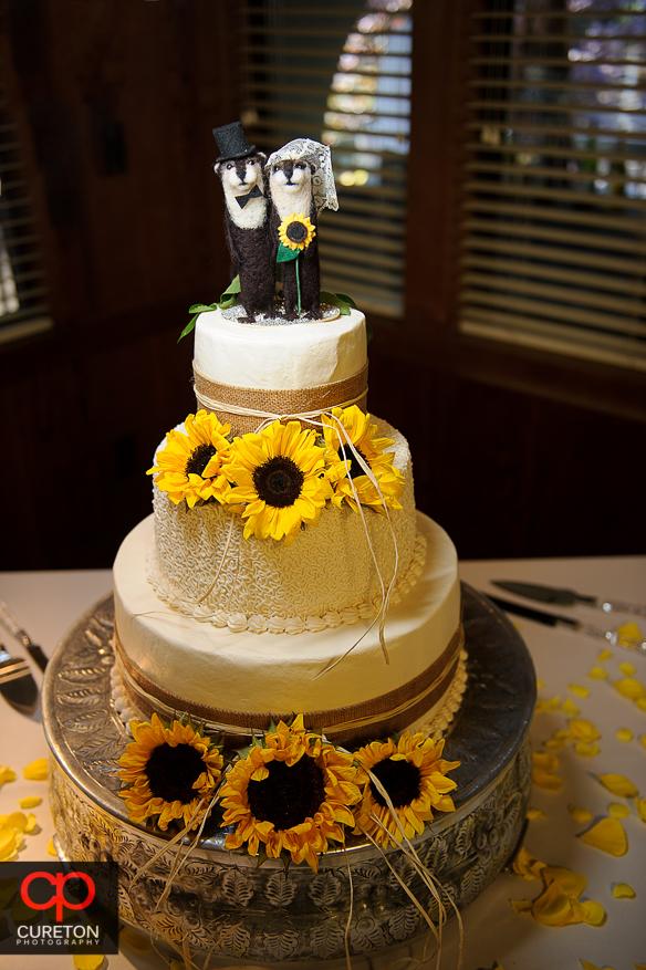 Creative use of sunflowers on the wedding cake.