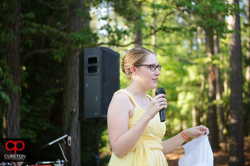 The maid of honor giving her toast at the wedding reception.
