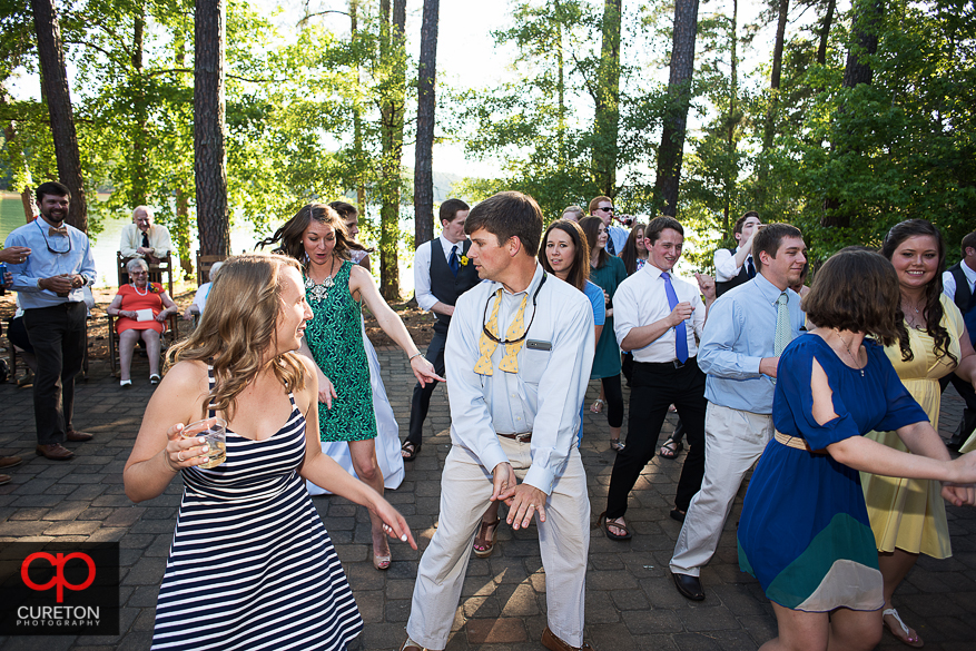 Guests dancing at the wedding reception at the Clemson outdoor lab.