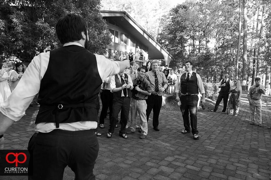 The groom tosses the garter.