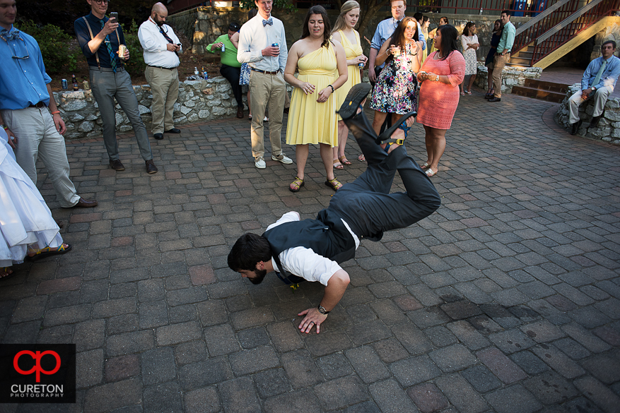 The groom doing the worm dance at his reception.