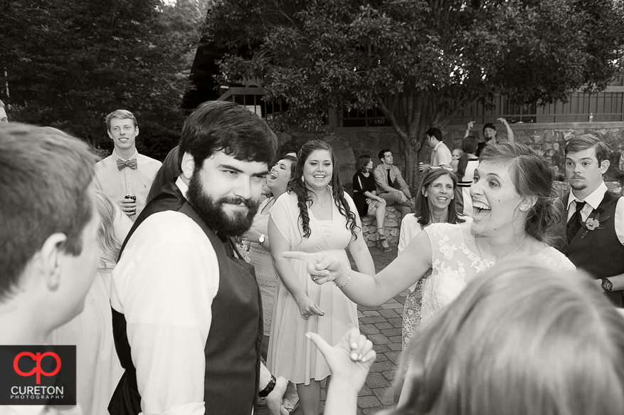 The bride and groom having fun at the reception.