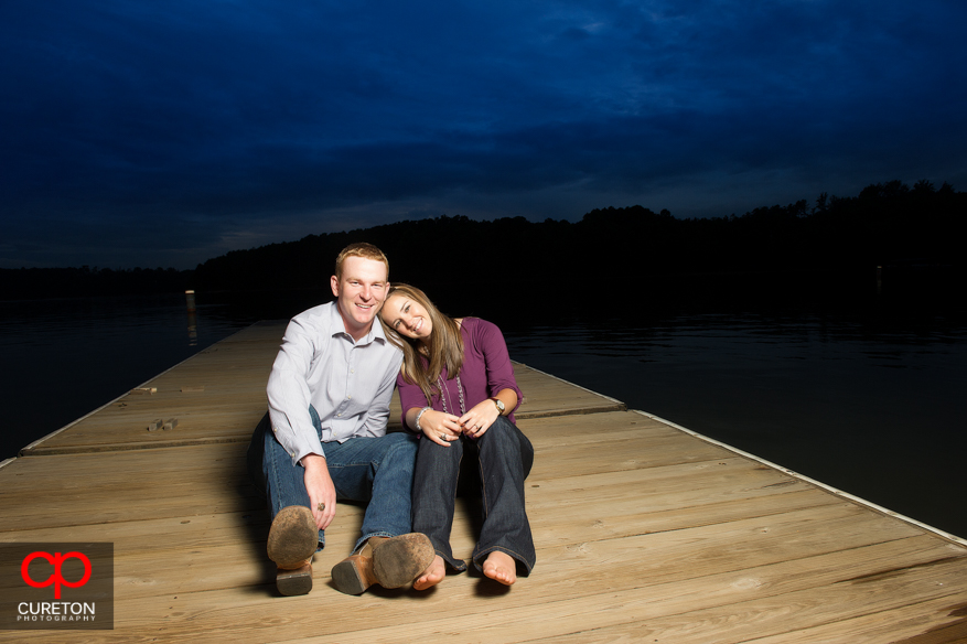 Couple relaxing on the dock at Lake Hartwell on the Clemson campus.
