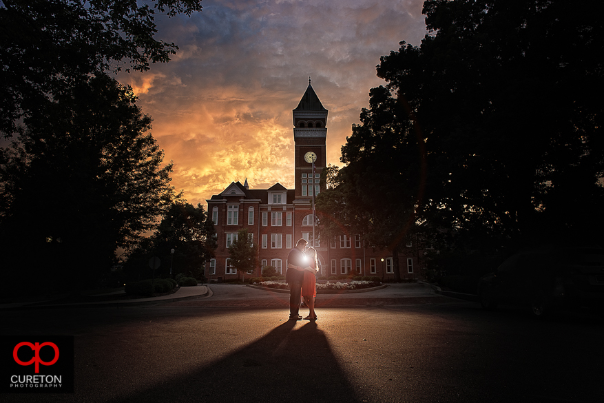 Engaged couple kissing in front of Tillman Hall during a Clemson University Engagement Session.