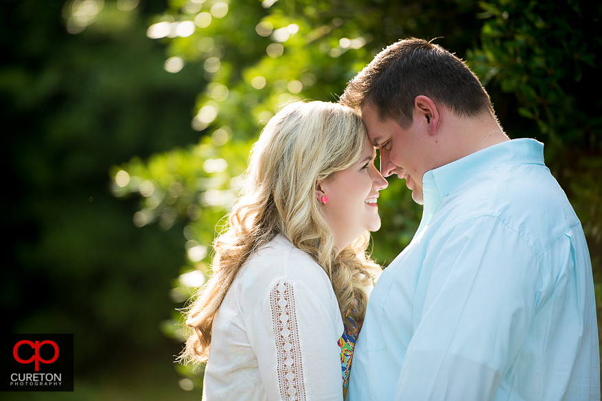 Couple looking into each other eyes during an engagement session on the Clemson University Campus.