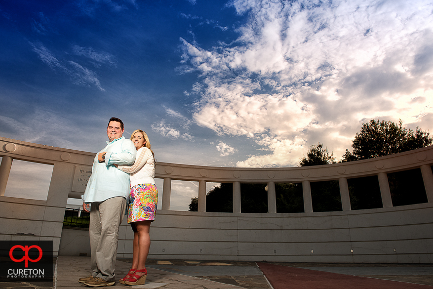 Engaged couple in from of the amphitheater in Clemson.