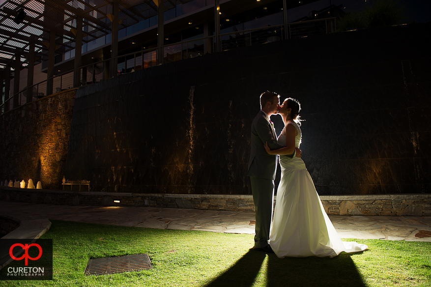 Newly married couple in front of the water wall outside the Peace Center in downtown Greenville,SC.
