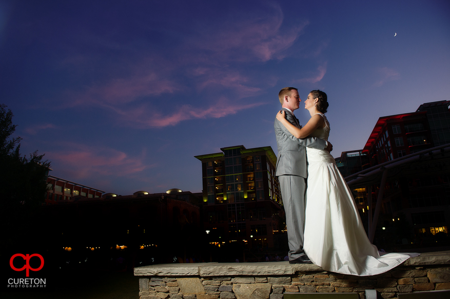Couple dancing under the skyline of Greenville,SC at sunset.