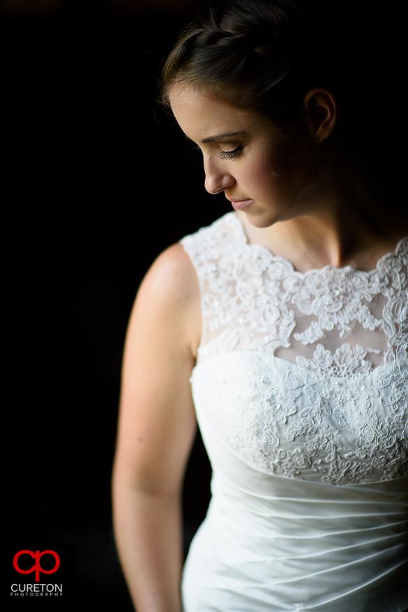 Beautiful bride standing in window light.