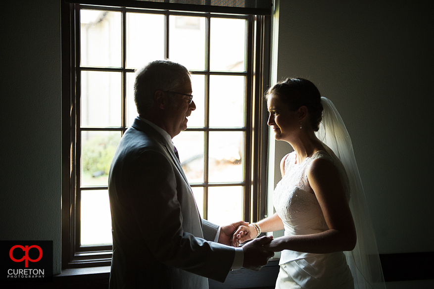 Bride's father sees her for the first time.