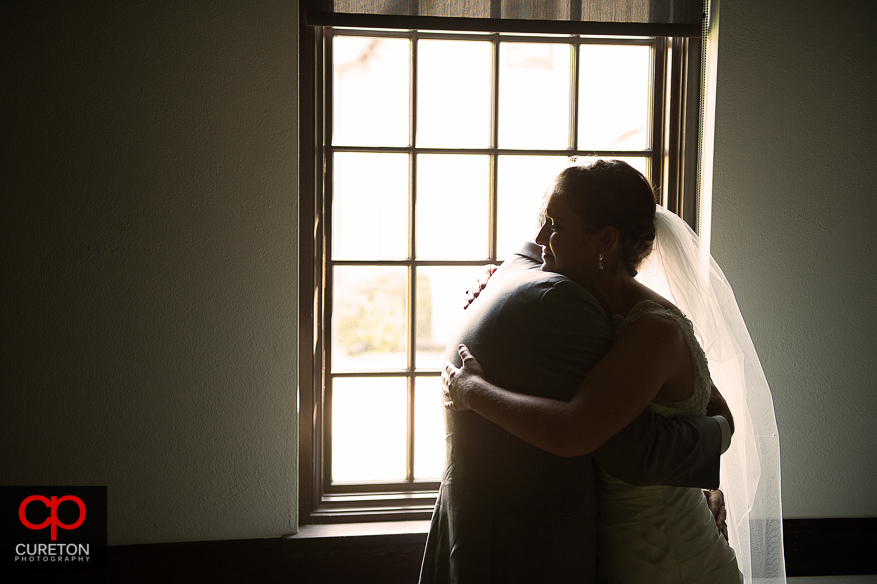 Bride and her father hugging during a first look.