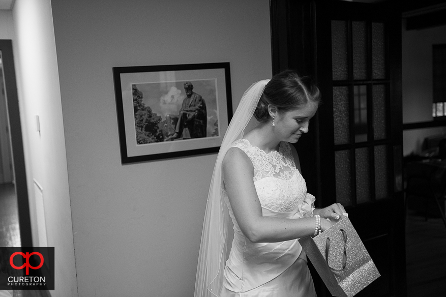 The bride receives a gift from her groom.