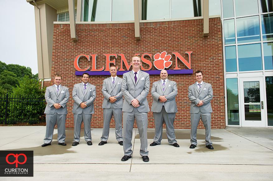 The groomsmen standing outside the Clemson indoor football complex.