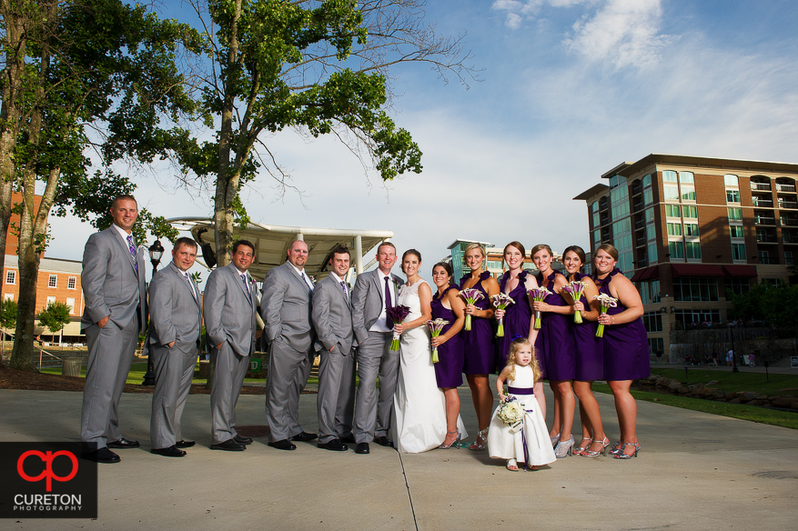The wedding party standing outside the Huguenot Loft in downtown Greenville.