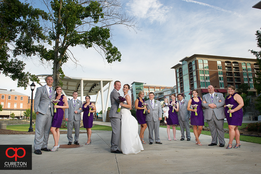 The wedding party posing very Vanity Fair style in downtown Greenville,SC.
