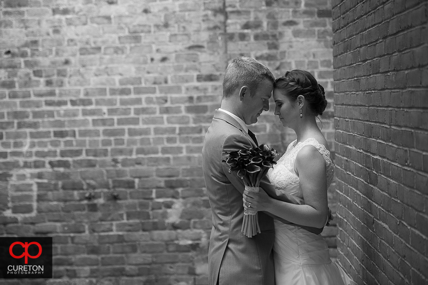 The bride and groom share a moment outside the Huguenot Loft before their wedding reception.