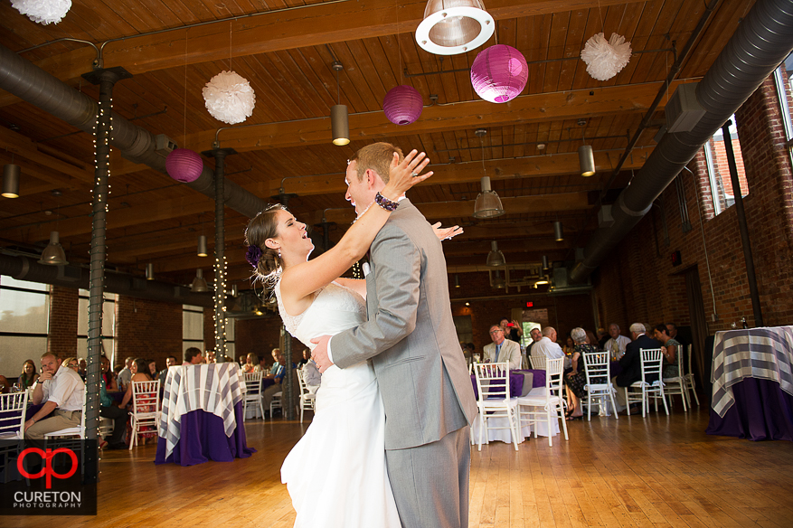 The bride and groom share a first dance.