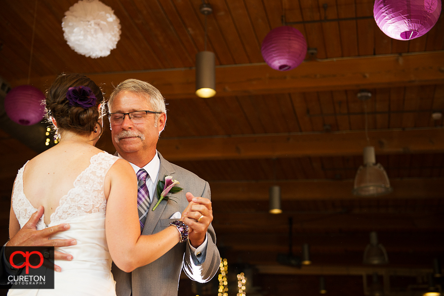 The bride dances with her father.