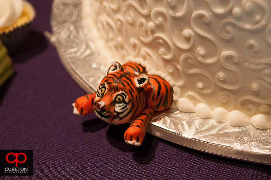 A CLemson tiger coming out of the wedding cake.