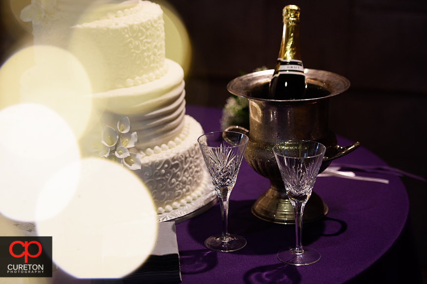 Decor from the downtown Greenville wedding reception with purple color theme.