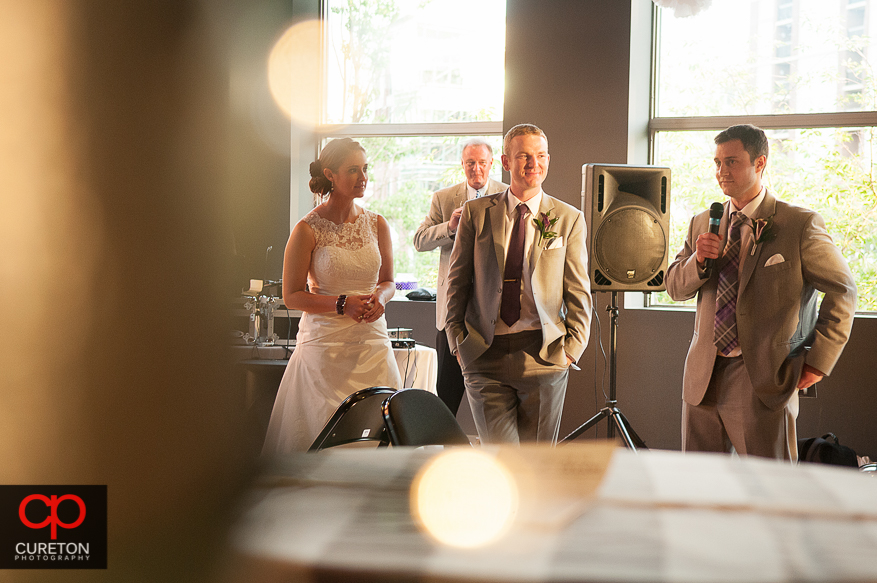 Creative shot of eth best man giving a toast.