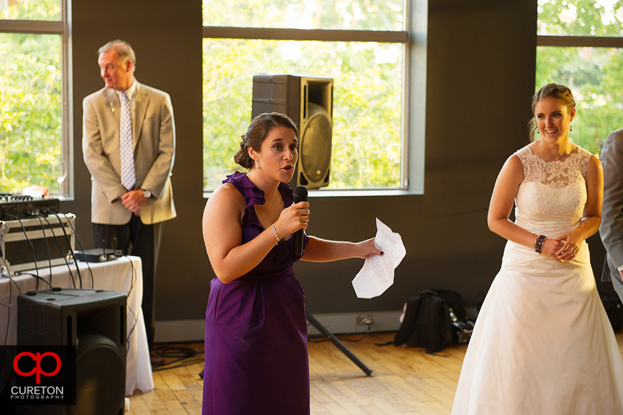 The maid of honor giving a toast.