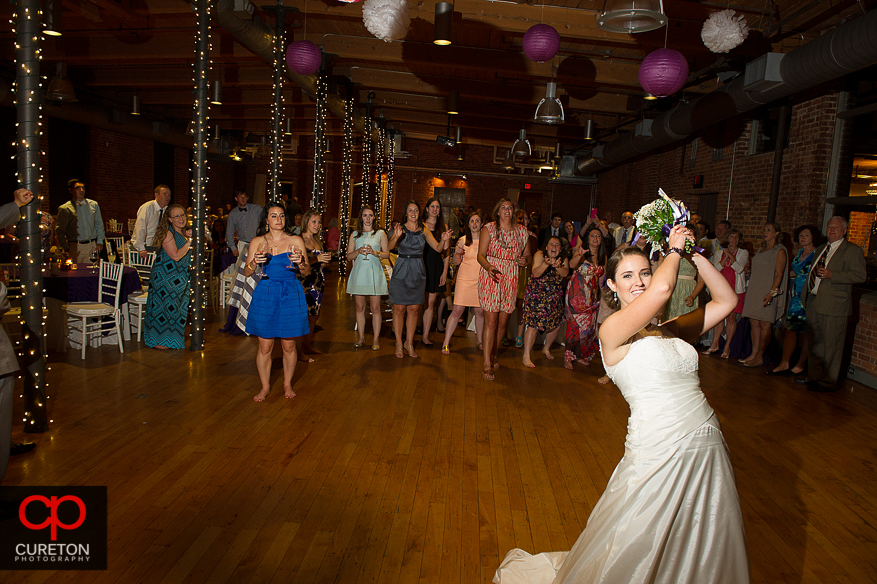 The bride gets ready to toss the bouquet.