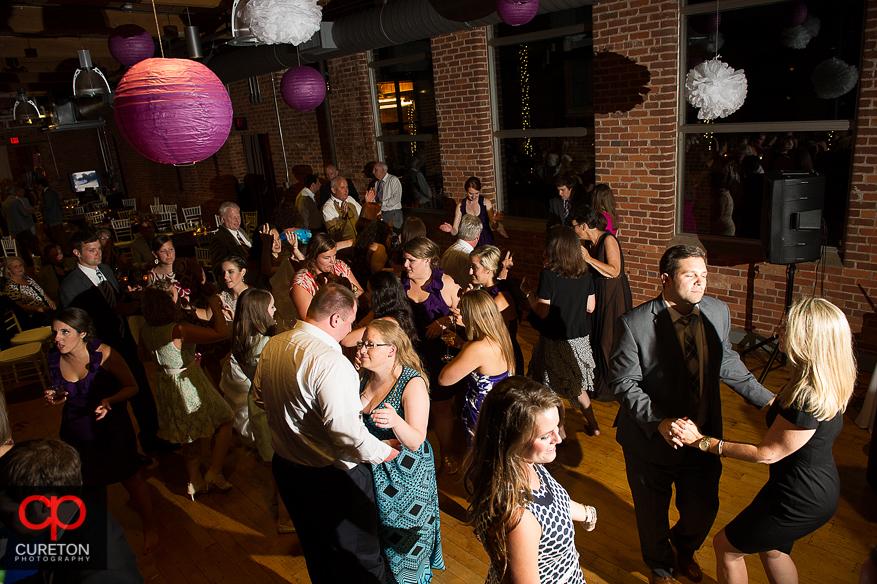 Wedding guest dance the night away at the Huguenot Loft in Greenville,SC.