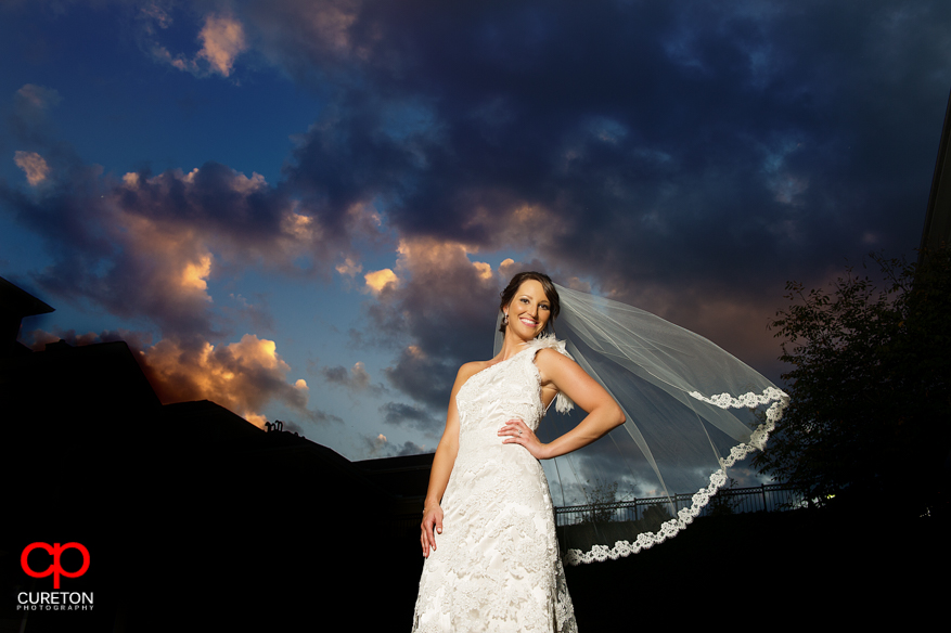 Bride with veil blowing at sunset in Cleveland Park.