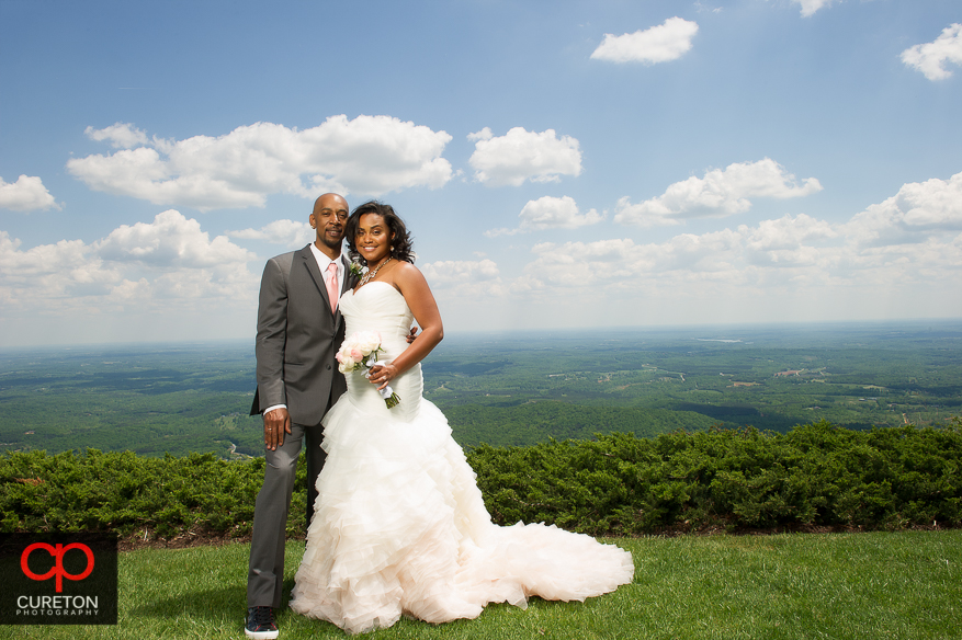 Couple on the top of the mountain after their wedding at Cliffs at Glassy Chapel.