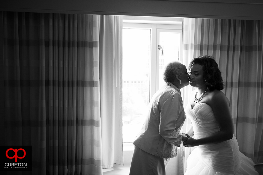 Bride and mom share a moment before her wedding at the Cliffs.