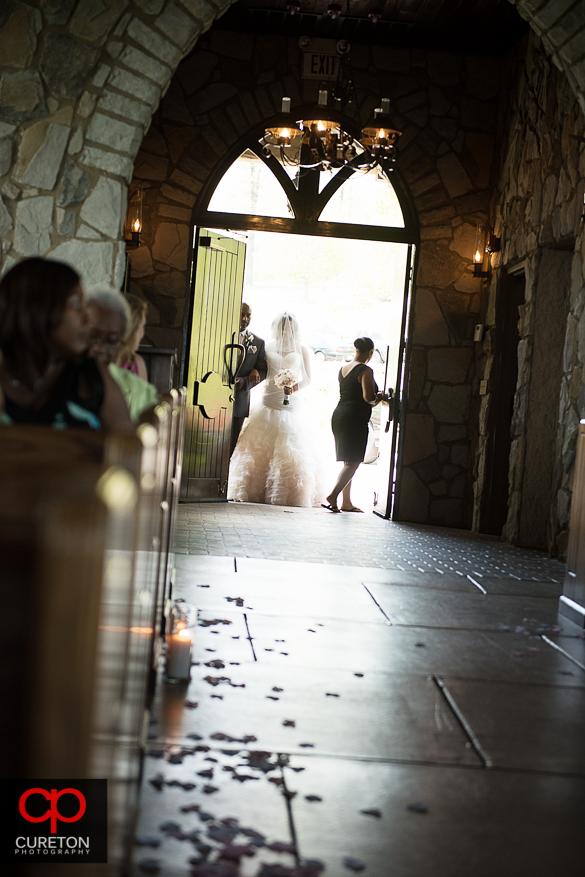 The bride enters Glassy Chapel.