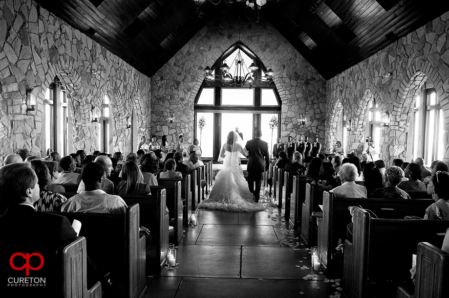 The bride walking down the aisle at Cillfs at Glassy.