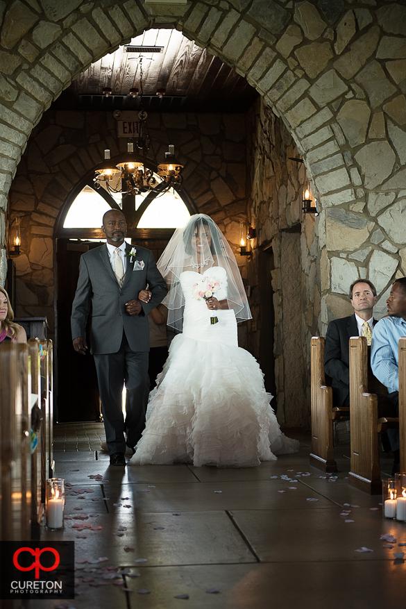 Bride walking dow the aisle at Glassy Chapel.