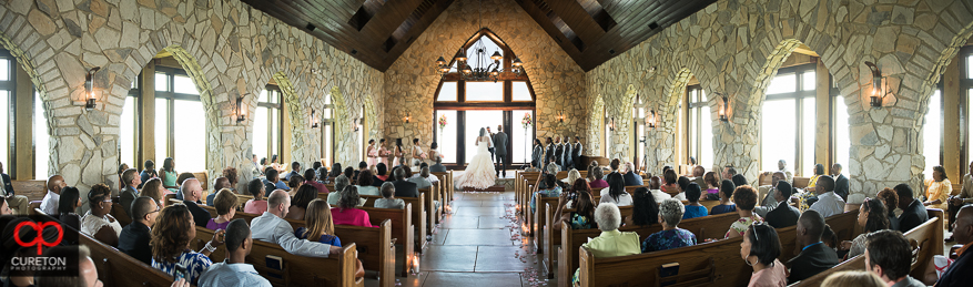 Pano of Cliffs at Glassy Chapel interior during a wedding.