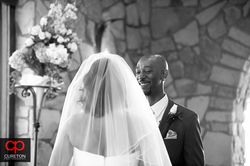 Groom smiling during a wedding.