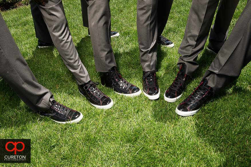 The groomsmen showing off their patent leather Chucks.